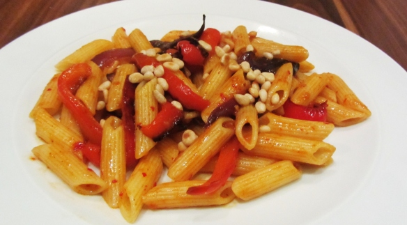Roasted vegetables, harissa and pine nuts served with pasta