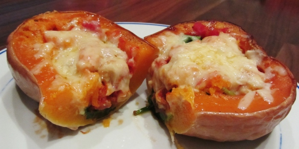 Butternut squash stuffed with tomato, cannellini beans and spinach and topped with cheese