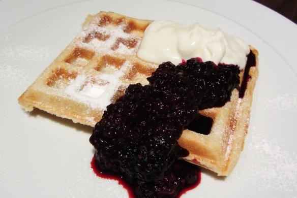 Healthy waffles with yoghurt and blackberries
