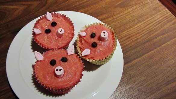Pig cupcakes with raspberry jam icing